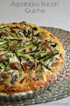This Asparagus Bacon Quiche is full of smoky bacon with fresh asparagus and creamy shredded cheese. by Lady Behind The Curtain