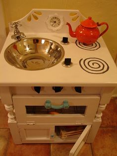 Repurposed cabinet becomes a Play Kitchen by kumari_kt via Flickr. Ada likes this one. :) #playkitchens