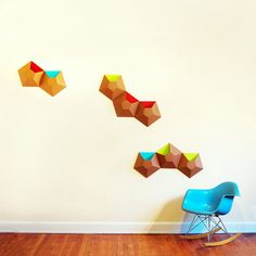 Wallpockets Sky Blue 2 Pack  by Ampersand  Wallpockets are inspired by simple geometric shapes and the curious compositions created by clusters of barnacles. This pack includes two pentagonal pockets die-cut from 100% recycled cardboard. Hide your favorite things within and activate a formerly underutilized wall-space with a textural depth that beckons exploration. Wall pockets are reversible.