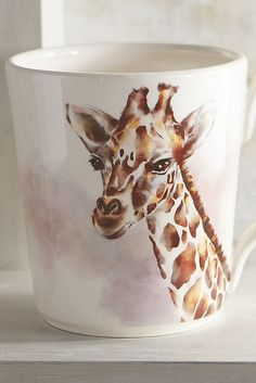 Forget blending in. Pier 1's Giraffe Mug makes a unique gift for someone who stands out. It serves up an exotic touch, whether it's used for morning coffee at the office or displayed in a kitchen. Smartly crafted of dishwasher-safe and microwaveable glazed ironstone.