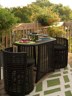 The round chairs tuck beneath the table, disappearing into the oval shape of the synthetic-wicker dining set: http://www.bhg.com/home-improvement/deck/ideas/small-deck-decorating/?socsrc=bhgpin042214multitaskingfurniture&page=6