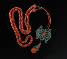 Coral & Kingfisher Feather necklace via the www.SusanDods.com Collection.