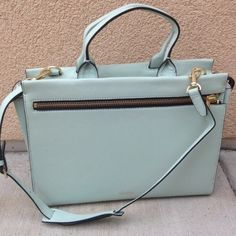 Kate Spade Seafoam Satchel Kate Spade Saturday Leather crossbody satchel with zip-front pocket Adjustable & removable padded shoulder strap / Handheld strap One interior pocket Zip-top closure  Materials: Leather / Jacquard lining / Metal hardware  Size: 7''H x 9.5''W x 4.25''D Handle drop: 4.25''NO TRADES. Please use the make an offer function as I do not negotiate in the comments. Thanks! Shoulder strap: 22'' includes dust bag! kate spade Bags Satchels