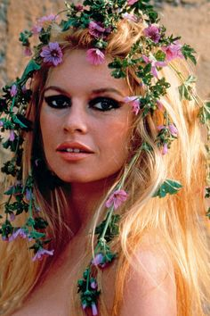 Brigitte Bardot, a perfect example of festival inspiration. Flower crowns may go out of style but this look will not. #2020AVEXCOACHELLA