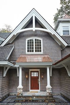 ADD THIS ENTRANCE TO  LAUREL LOVE THE COMBINATION OF SHINGLES AND COPPER COLOR METAL ROOF