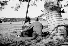 An American G.I. places his arm around a Japanese girl as they view the surroundings of Hibiya Park, near the Tokyo palace of the emperor, on January 21, 1946.