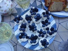 Perfect summer dessert in 15 minutes or less! 1) Divide in half 6 apple marshmallows (zephyrs), arrange on a big plate. 2) Spread a healthy amount of Mascarpone on each half. 3) Decorate with fresh summer berries (blueberries and blackberries in the picture).  4) Pour a glass of cold white wine and enjoy! Summer Berries, Blackberries, Summer Desserts, Marshmallows, White Wine, Blueberry, Cold, Plates, Apple