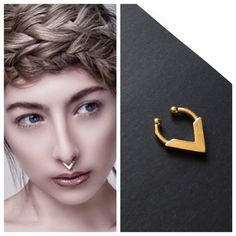 A modern tribal style gold septum ring that clips on to your nose for a fierce look. Material: Gold plated stainless steel Size: Height - 17mm,