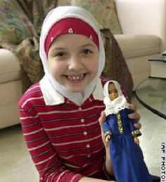 "This young girl is holding a Fulla Doll (the muslim equivalent of Barbie). Her name is Fulla. Girls will be encouraged to dress like Fulla. Fulla's activities mostly include shopping, spending time with her friends, cooking, reading, and praying. There will eventually be a doctor and a teacher Fulla doll, as ""these are two respected careers for women that we would like to encourage small girls to follow.""  http://mieraforever.blogspot.ca/2007/11/fulla-islamic-barbie-alternative-for.html"