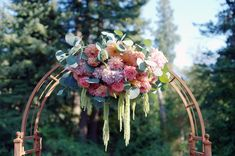 Pink Lavender Green and Orange Arch Garland | photography by http://www.deylahussphotography.com/
