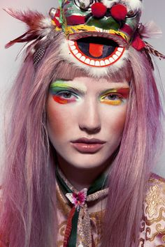 This editorial by Fiasco Magazine features stunning pastel hair colours and African-inspired bold colourful 'face-paint' make up for this tribal vibe. Native looks are fun and trendy with vibrant colours and rich accessories like these feather-headdresses.