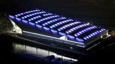 The Water Polo Arena is illuminated in the night. It was the final sporting venue on the Olympic Park to be built.