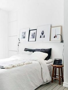 I like the shelf with framed photos stacked along it. Could do this in the living/dining room