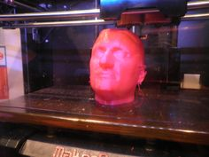 The head of Alessandro scanned with a 3D scanner and printed with 3d printer during the event