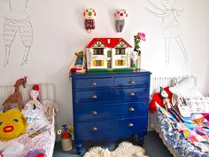 jess quinn's kid's room--love the little iron headboards. And the dollhouse. And the drawings on the wall. And...