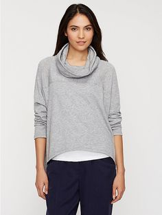 """EILEEN FISHER: Sunday Morning Eco,  Style No. F5LTJ-T3064M,   Sweatshirt chic. A heathered terry top with a funnel neck and dipped hemline.      Easy, boxy shape with just enough slouch.     Uneven hemline, cropped in front with dipped sides.     Funnel neck collapses artfully on the body.     Soft and drapey Tencel® with a heathered color and fine loops inside.     Model featured is 5'9 1/2"""".  Hand wash cold. May be dry cleaned. Made in China of imported fabric. 83% Tencel/17% Nylon $248"""