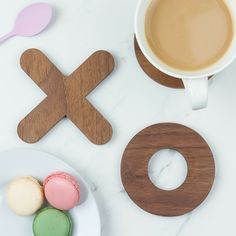 Noughts and Crosses Coaster Set | Create Gift Love £75  Inject some fun into tea time with this Noughts and Crosses Coaster Set.Made from solid walnut wood, the coasters are functional yet double up as a board game.  http://www.creategiftlove.co.uk/collections/personalised-wood-coasters/products/noughts-and-crosses-coaster-set  #noughtsandcrosses #coasters #creategiftlove