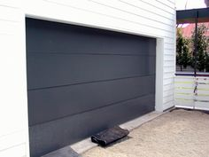 Cladding a flush sandwich construction insulated door with metals such as paint grip, cold rolled steel, galvanized steel, copper, Kynar coated roofing sheet, zinc or other material completely