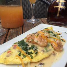 , Veggie Omelet topped with Creamy Cajun Shrimp Sauce..
