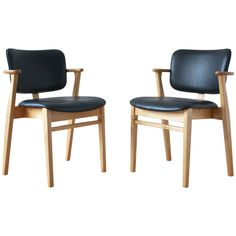 Pair of Domus Armchairs by Ilmari Tapiovaara | From a unique collection of antique and modern armchairs at https://www.1stdibs.com/furniture/seating/armchairs/