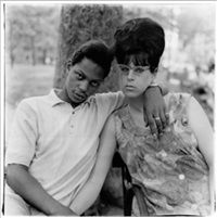 A young man and his pregnant wife in... by Diane Arbus
