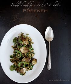Freekeh salad with fiddlehead ferns and artichokes~ astackofdishes.com
