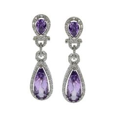 14kt White Gold Pear Drop Amethyst and Diamond Earrings - Amethyst 5.44ct* - Crafted in 14ktwhite gold - Round Diamonds 0.30ct * total weight - H-I color, SI1-SI2 clarity - Measures 1 3/8 inches x 3/8