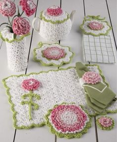 """Watch the Carnation Kitchen Set Crochet Pattern product review video! Design by: Maggie Weldon Skill: Easy Size: Hot Pad - 7"""" across Pot Holder - 8"""" across Towe"""