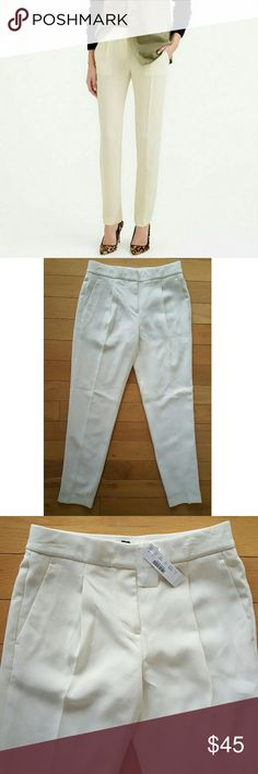 J.CREW cream pleated crepe pants Sz 0 J.CREW cream pleated crepe pants.  Sz 0 Sits above hip. Relaxed straight leg.  Tab close. Lined. Faux back slit pockets  Waist approx 15 inches across Rise almost 11 1/2 inches high Inseam almost 30 inches long J. Crew Pants Trousers