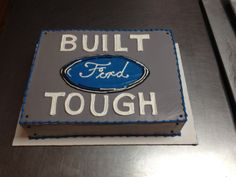 Built Ford Tough grooms cake with special permission from Ford to use their logo. Wild Flour Bakery.