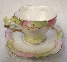 ANTIQUE FLOWER SHAPED DEMITASSE CUP & SAUCER LEAF & TWIG HANDLE