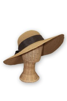 0a05cfba167 UPF 50 straw derby hat with a Southern flair. Great for the summer derby or  your next vacation. Feminine bow accent in the back and sizing drawstring.