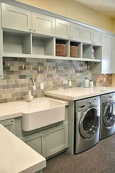 Please can I have this laundry room!!! Great mix of open and closed storage I love the big sink. And the interplay of colors and textures is lovely.