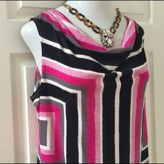Calvin Klein geometric top Beautiful Calvin Klein top has a pattern that is designed to create a wonderful slimming effect. Draped neck is ultrafeminine. Only worn once or twice. Polyester. 21 inches bust, 19 inches waist, 24 inches length Calvin Klein Tops