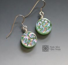 "Green dichroic glass earrings feature shimmering accents of pink & blue. Glass measures "" in diameter. Glass Earrings, Drop Earrings, One More Step, Dichroic Glass, Simple Earrings, Glass Design, Wearable Art, Wire Wrapping, Pink Blue"