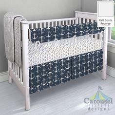 Crib bedding in Navy Anchors, Watercolor Lifesavers, Gray and White Rope, White and Gray Waves. Created using the Nursery Designer® by Carousel Designs where you mix and match from hundreds of fabrics to create your own unique baby bedding. #carouseldesigns