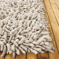 """Nesta Rug.  Kick off your shoes and take a walk over the Nesta Rug (2010). Luxuriously soft, this handmade shag rug feels wonderful underfoot, offering a warmth and textural counterpoint to any residential or commercial setting. Made from undyed grey or cream wool, it has a neutral coloration that, with its generous 3"""" shag, will be quietly noticed and appreciated."""