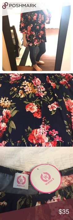Off the shoulder floral blouse 🌸🌷🌺 NWT. Navy blue top covered in pink, yellow and red florals. Perfect spring top! Can be worn on or off the shoulder due to elastic neckline. Slight ruffle around sleeves and hem. boutique Tops Blouses