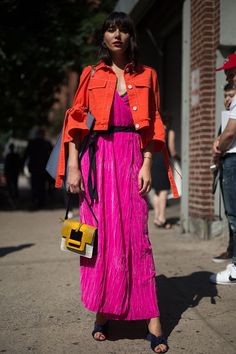 """Instead of wearing a traditional denim jacket over your pink dress, wear a red one. The style switch-up is easy to pull off, as Natalie Suarez showed here. She also wore M Missoni's """"Maxi Tote"""" for an extra pop of color. Looks Street Style, Street Style Trends, Street Style Women, Look Fashion, Fashion Outfits, Fashion Tips, Fashion Trends, Spring Fashion, Womens Fashion"""