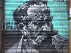 Man with mustache - painted shutter - Barcelona