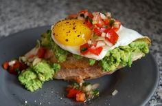 Californian avocado brunch toasts with pico de gallo and sunny side up eggs