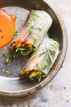Vegetarian and gluten-free pad thai spring rolls with vegan and gluten-free, all-natural, healthy red curry peanut sauce.