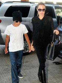 e61d04cb9b4 Angelina Jolie hit up LAX in a chic all-black jet-setting outfit