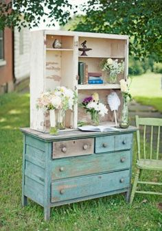 Old dresser used as a vintage wedding guest book table at an outdoor vintage wedding.  Photo: Lifework Media Blog.