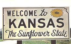 Kansas - welcome sign   --   Welcome to Kansas - the Sunflower State - These signs appear on all major highways as you cross the State Line to enter the Sunflower State. - postmarked in 1959 with 3 cent Liberty stamp