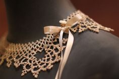pretty crochet-lace collar with ribbon bow