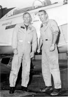 The first man on the moon, Apollo 11 CDR Neil Armstrong, and the last man on the moon, CDR Gene Cernan, share a smile beside their jet. (Looks to be a 2 seat trainer).
