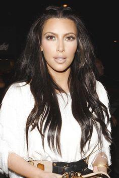 Kim Kardashians lush, brunette hairstyle