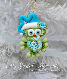 This is s one of a kind, handcrafted ornament made of durable polymer clay, with much attention given to detail and careful construction. No molds have been used, so you can be sure you are receiving a unique and one of a kind keepsake. This ornaments measures approximately 2 inches wide by 3 inches tall not including the ribbon hanger. The item in the photo is the exact item you are purchasing and will receive, as I do not like to create the same thing twice :) This beautiful owl ornam...