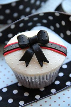 Wonderfully chic and pretty black, white  red Polka Dot Bow Cupcakes. #food #cupcakes #bows #dessert